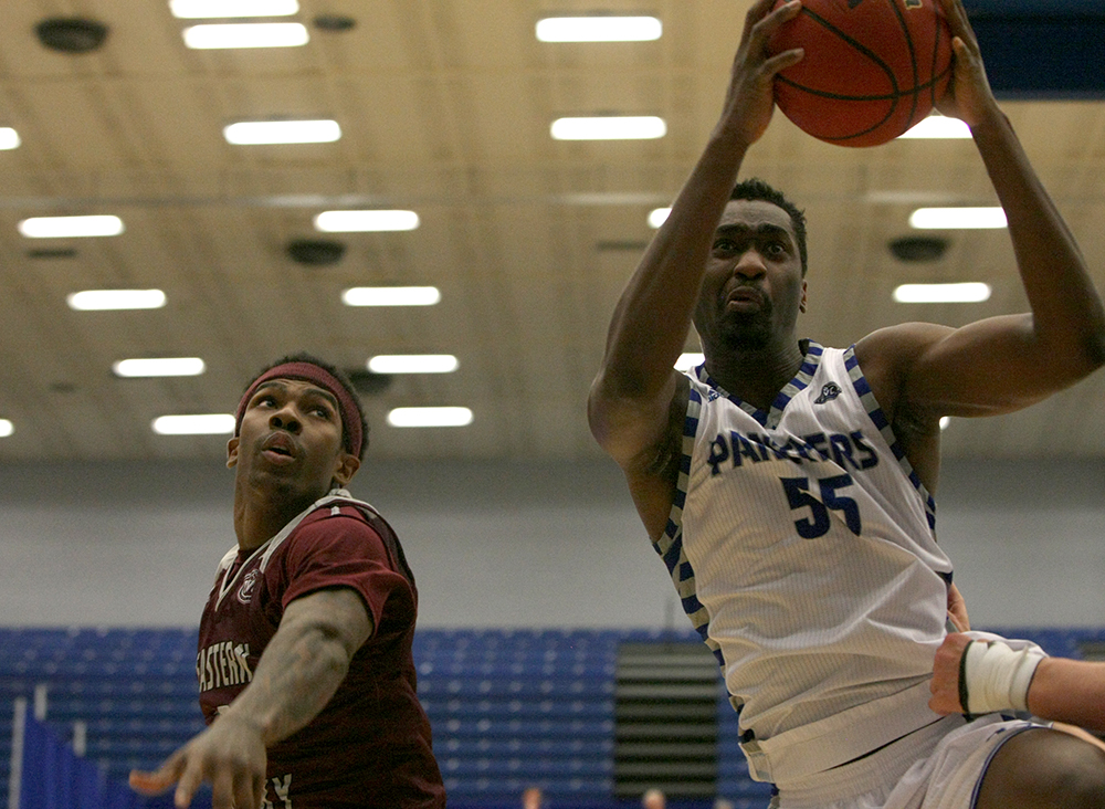 Eastern center Aboubacar Diallo grabs a rebound in Eastern's 67-66 win over Eastern Kentucky Thursday night in Lantz Arena. Eastern is now 6-3 in conference play.