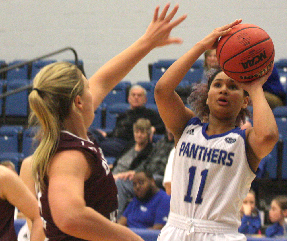 Eastern guard Karle Pace takes a shot in the Panthers 80-60 win over Eastern Kentucky Thursday night in Lantz Arena. Pace scored a game-high 29 points in the win.