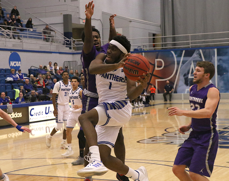 Eastern+guard+Kashawn+Charles+drives+the+basket+in+a+Panthers%E2%80%99+win+over+Fontbonne+in+December.+Eastern+lost+to+Jacksonville+State+69-62+on+Thursday.