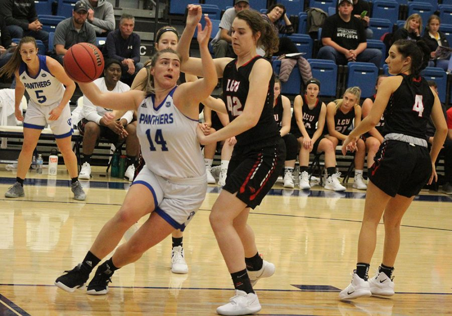 Eastern sophomore Grace McRae drives under the basket after receiving a pass from Grace Lennox (5) against Lincoln Christian on Nov. 12 in Lantz Arena. McRae had four points and five rebound in a 78-49 loss to Jacksonville State on Thursday.