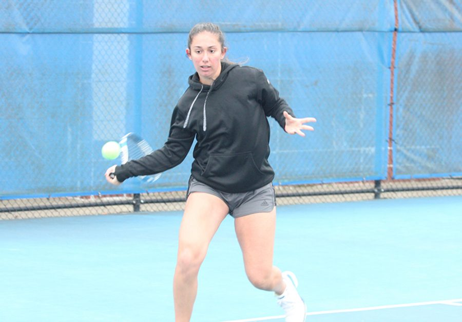 Eastern+sophomore+Rachel+Papavasilopoulos+returns+a+ball+in+a+fall+practice+at+the+Darling+Courts.+Eastern+travels+to+play+Judson+University+and+Olivet-Nazarene+on+Saturday.