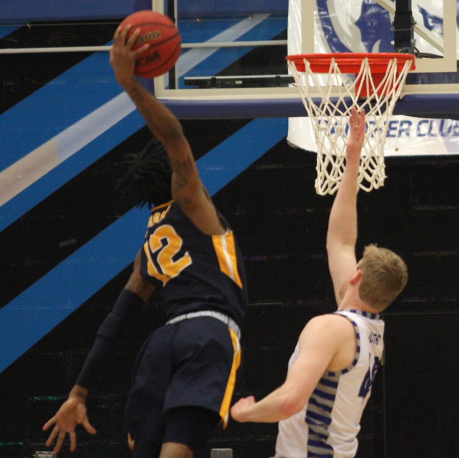 Murray State sophomore guard Ja Morant dunks over Eastern's Lucas Jones in Murray State's 83-61 win over Eastern Thursday at Lantz Arena. Morant had a game-high 27 points.