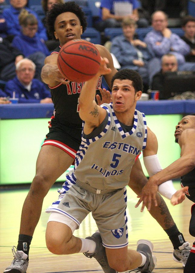 Eastern point guard Shareef Smith tries to keep a ball in Eastern's posession during the Panthers' 85-83 win over Austin Peay on Saturday in Lantz Arena. Smith made a game-winning shot with four seconds remaing to give Eastern the win.