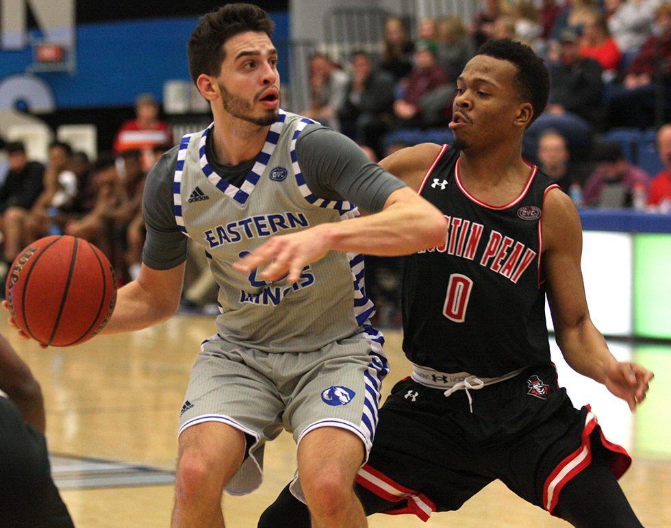 Eastern junior Josiah Wallace backs down an Austin Peay defender in the Panthers 85-83 win over the Governors Saturday in Lantz Arena. Eastern is now 4-2 in the OVC after the win.