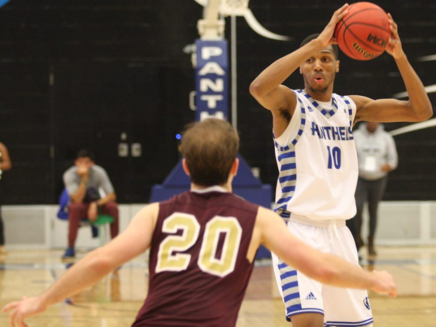 Cam Burrell looks to pass the ball to an open teammate during Eastern's 79-44 victory over Eureka College in an exhibition match in Lantz Arena Nov. 2.