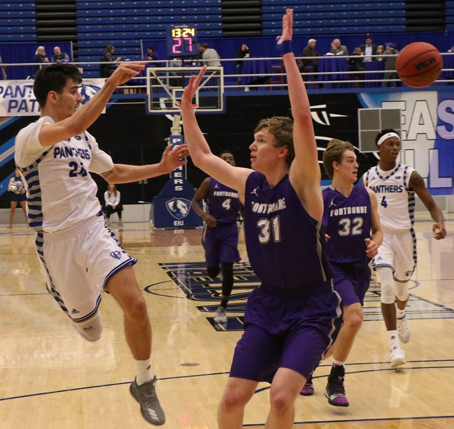 Rade Kukobat attempts a jump-pass during a fast break during Eastern's 90-37 victory over Fontbonne University on Dec.4 in Lantz Arena.