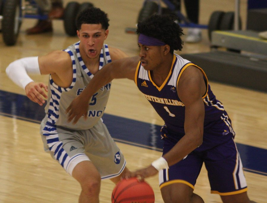 Shareef Smith defends a Western Illinois ballhandler during Eastern's 68-66 overtime victory over the Leathernecks in Lantz Arena Nov. 17.