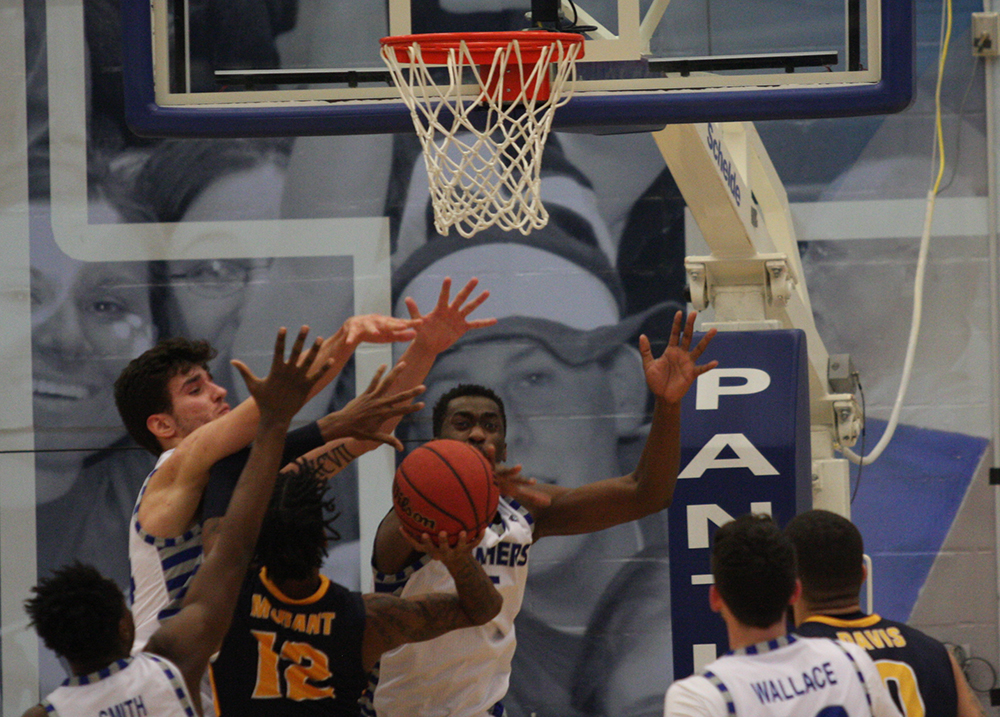 Rade Kukobat and Aboubacar Diallo try to block Ja Morant's shot attempt during Eastern's 83-61 loss to Murray State in Lantz Arena Jan. 17.