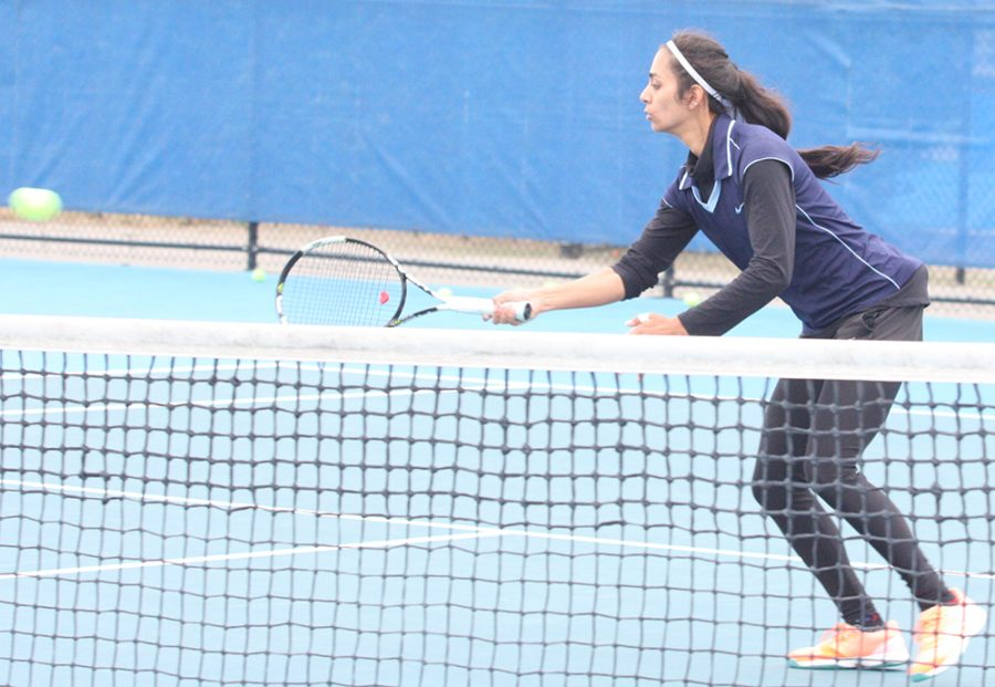 Srishti Slaria prepares to return a hit during the Eastern women's tennis practice at the Darling Courts Oct. 14.