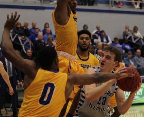JJ Bullock | The Daily Eastern News Eastern freshman Ben Harvey drives the basket through a scrum of Morehead State defenders in the Panthers 84-78 loss Saturday in Lantz Arena. Harvey had 11 points on 5-of-8 shooting.
