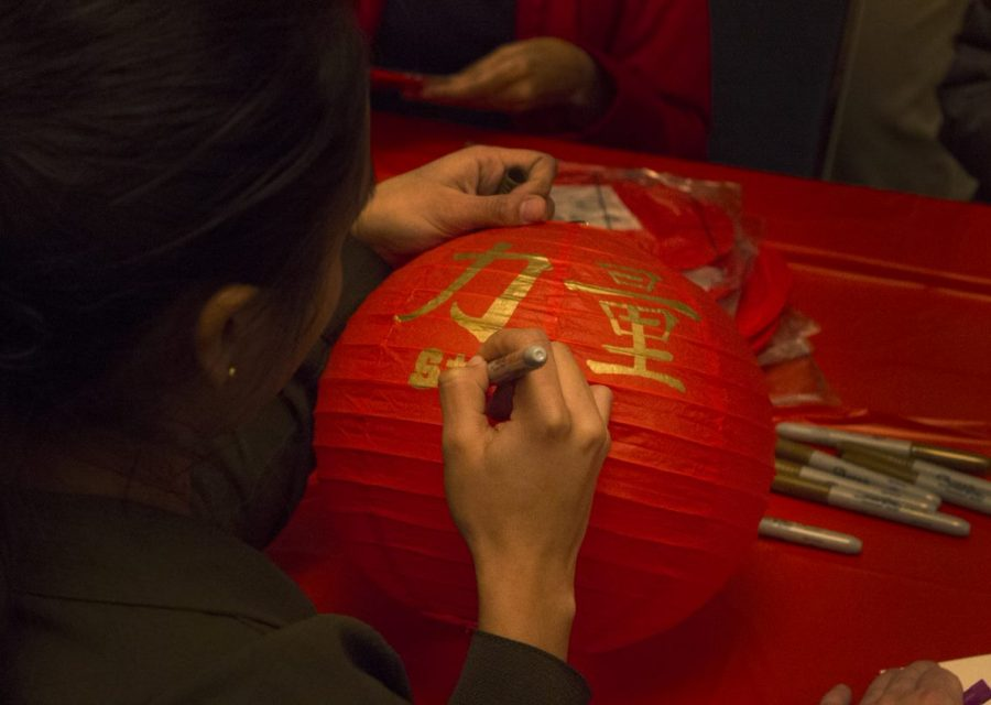 Raine Zhu | The Daily Eastern News A student decorates a lantern at the Chinese New Year celebration Tuesday evening in the Martin Luther King Jr. University Union.