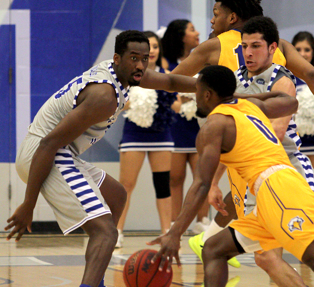 Aboubacar Diallo (far left) plays defense on a Morehead State player in Eastern's 84-78 loss to the Eagles on Saturday. Diallo is a native of the Ivory Coast.