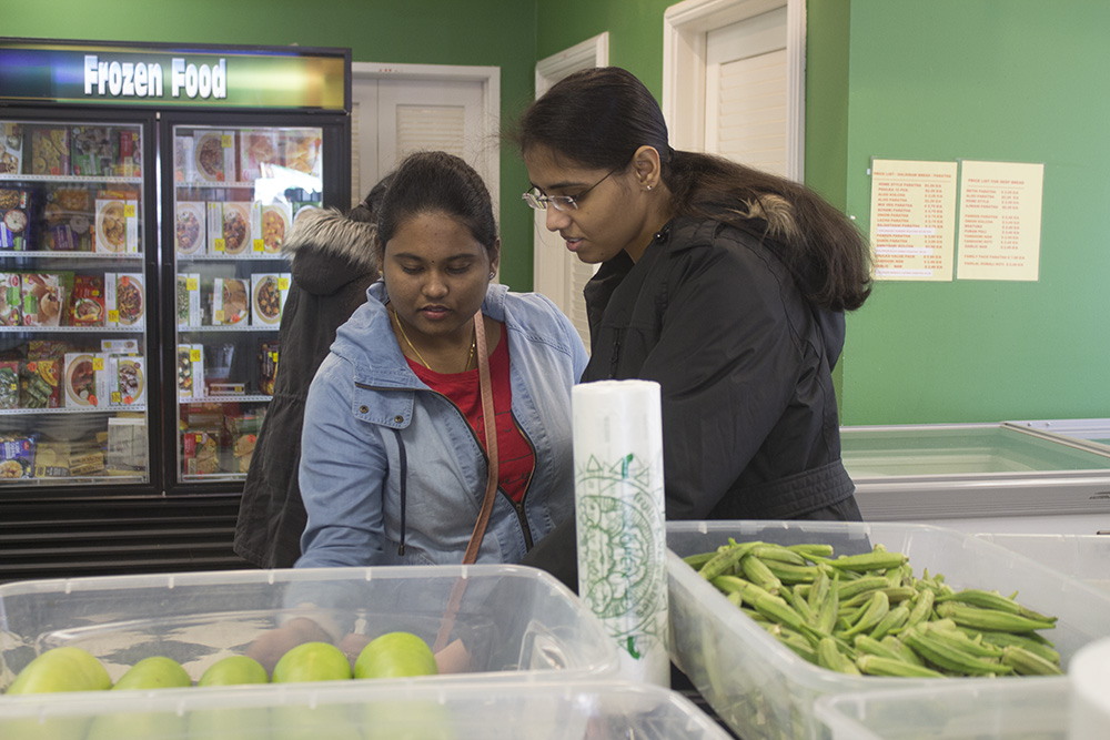 Sushma Saragadam (left), a graduate student in geographic information sciences, and Amulya Boddu (right), a graduate student in computer technology, shop at the Annapoorna store in Champaign on Saturday.