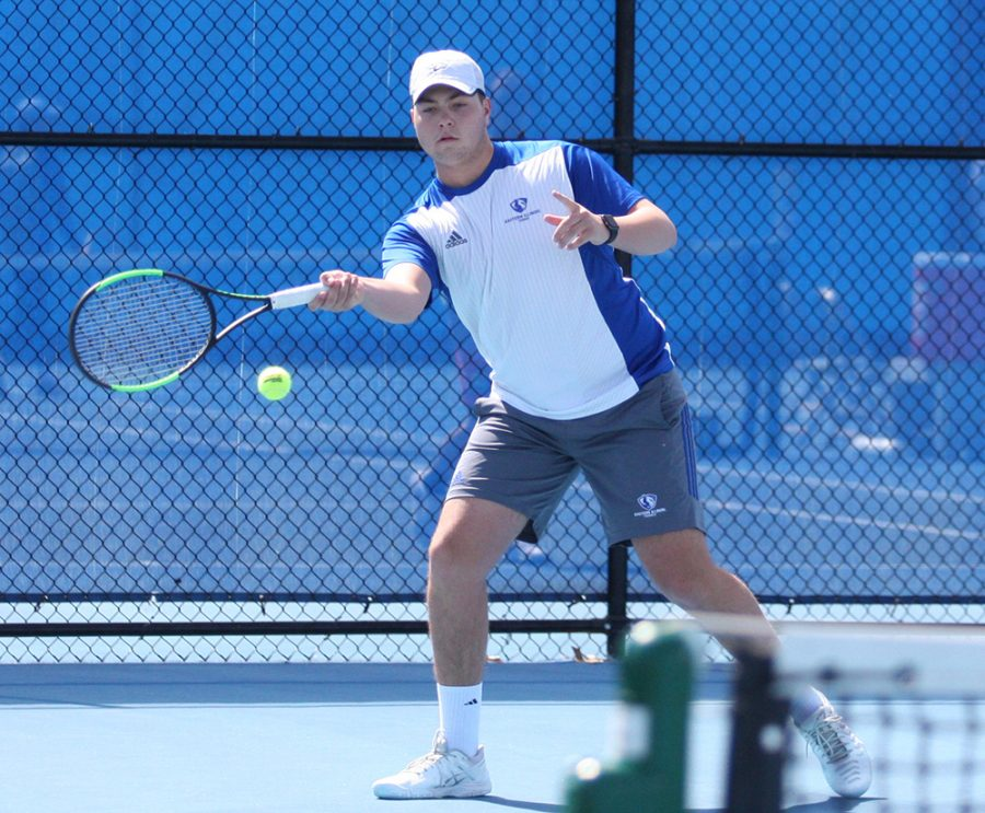 Eastern junior Gage Kingsmith returns a ball in a match last season at the Darling Courts. The men's tennis team is 6-6- this season.