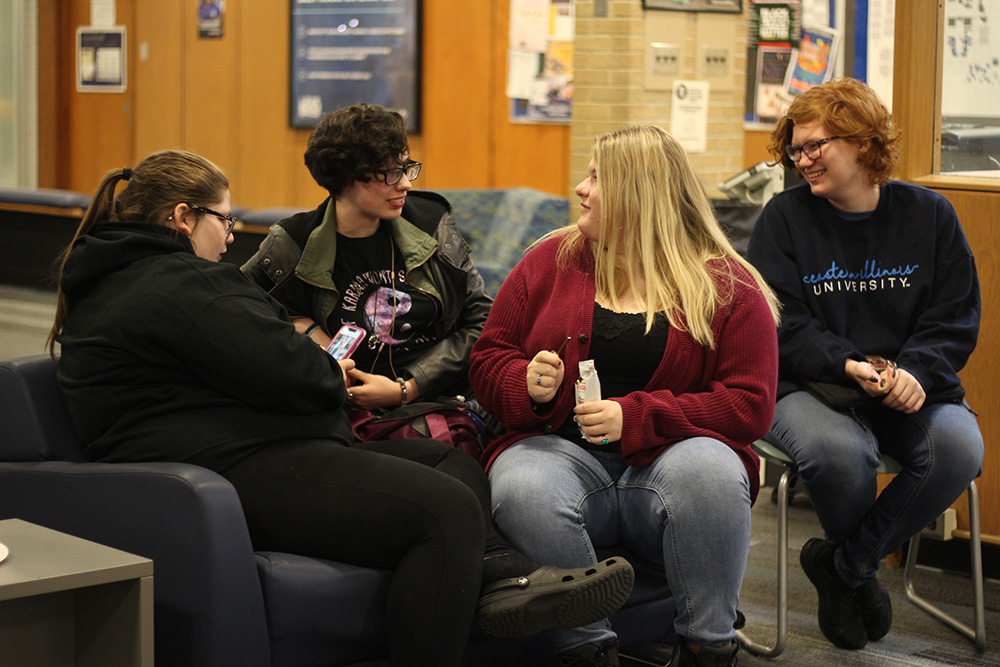 Morgan Bledsoe, a freshman journalism major, Journee Evans, a freshman english major, Makenna Boyd, also a freshman english major, and Lyric Ailshire, a freshman pre-medicine major, relax and enjoy themselves at the Thomas Hall Council Meeting held in the Thomas Hall lobby on Tuesday night.