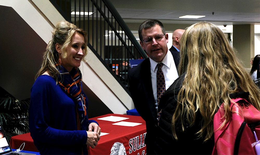Beth Probst (left), principal at Jasper County Junior High and Newton Community High School, talks to students at Small & Rural Informal Night Wednesday at Buzzard Hall.