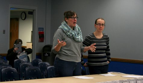 Beth Gillespie (left), the director of the office of civic engagement and volunteerism, and Crystal Brown (right), the assistant director, talk about rasing funds for Panther Service Day in front of members of the Student Senate at a meeting Wednesday.