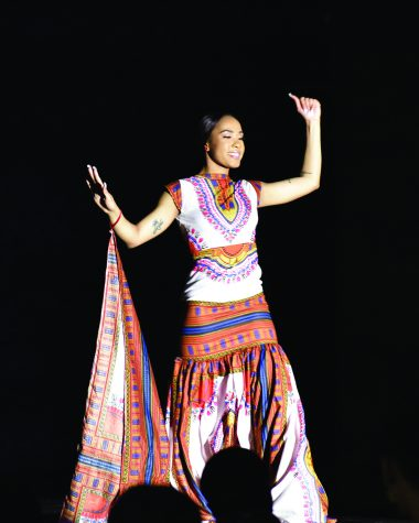 Latricia Booker, a sophomore pre-nursing major and one of the the contestants of the 48th annual Miss Black EIU scholarship pageant, dresses in African garment piece to show what she believes a strong African-American woman looks like in the Grand Ballroom of Martin Luther King Jr. Union on Saturday night.