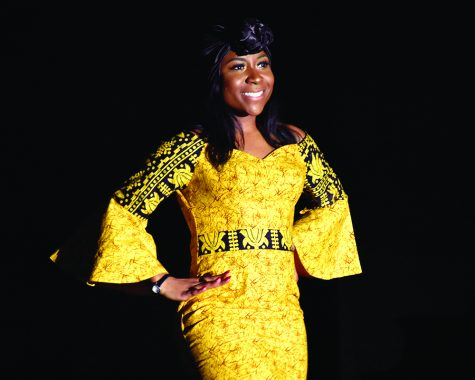 "Alexis Paige, a junior marketing major and one of the the contestants of the 48th annual Miss Black EIU scholarship pageant, dresses in African garment piece to show what she believes a strong African-American woman looks like in the Grand Ballroom of Martin Luther King Jr. Union on Saturday night. She said: ""We are beautiful in any shape."""