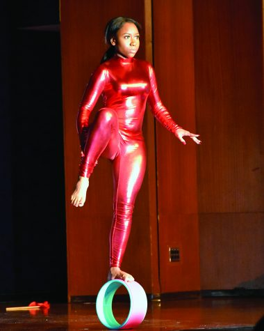 Alexis Paige, a junior marketing major and one of the the contestants of the 48th annual Miss Black EIU scholarship pageant, gives a circus act in the Grand Ballroom of Martin Luther King Jr. Union on Saturday night.