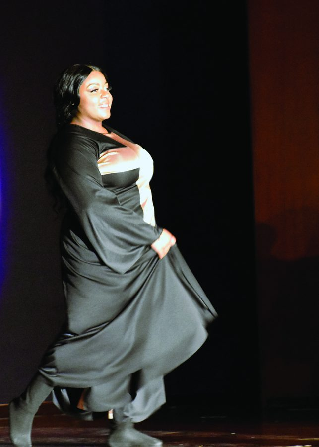 Mary Fleming, a junior applied engineering and technology major, perform a dance as her individual talent portion during the 48th annual Miss Black EIU scholarship pageant in the Grand Ballroom of the Martin Luther King Jr. Union on Saturday night.