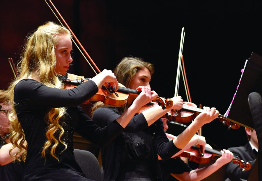 Sadie Armstrong, a member of the Symphonic Honers Initiative Program and pre-college violinist from Mattoon High School, plays violin during the Eastern Symphony Orchestra performance called The American Dream in the Dvorak Concert Hall of the Doudna Fine Arts Center on Sunday afternoon.