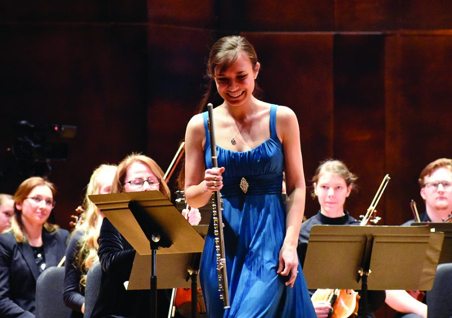 (RIGHT)Teresa Richard, a principal flutist of the Eastern Symphony Orchestra and a member of the Etcetera Trio, plays the flute as guest artist in the second piece of the ESO - The American Dream in the Dvorak Concert Hall Sunday afternoon. The piece she played is for solo flute, harp and string orchestra, which was called Serenade for Flute, Harp, and Strings, Op.35 by Howard Hanson.