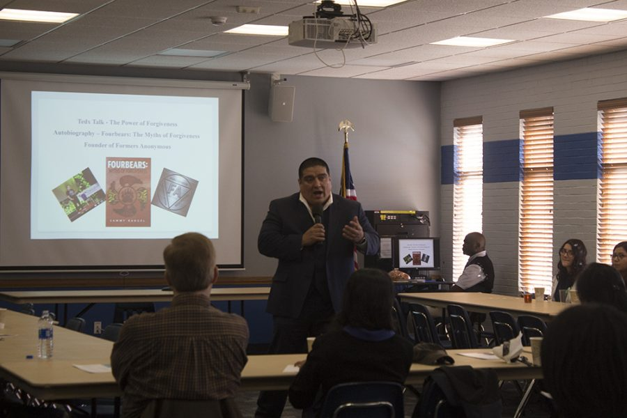 """Author Sammy Rangel gives a speech at the 2019 ICGD Symposium, held in the Arcola/Tuscola room at the Martin Luther King Jr. University Union on Tuesday afternoon. His speech was named """"A life born of a thousand wounds""""."""