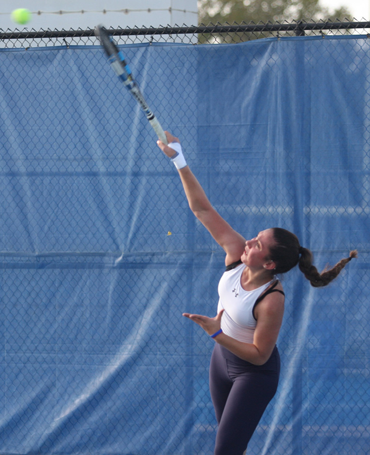 Sophomore Rachel Papavasilopoulos serves a ball in a practice this fall at the Darling Courts.