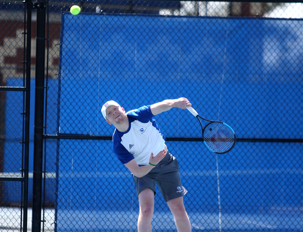 Eastern junior Freddie O'Brien returns a ball in a match last spring at the Darling Courts. O'Brien and Eastern have two matches upcoming this weekend.