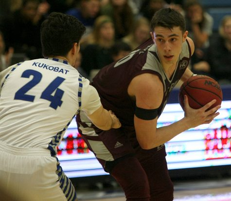 Eastern Kentucky's Nick Mayo works on Eastern's Rade Kukobat in Eastern Kentucky's 67-66 loss to Eastern on Jan. 31. Mayo is second in the Ohio Valley Conference in scoring (23 ppg) and also averages 8.2 rebounds per game.