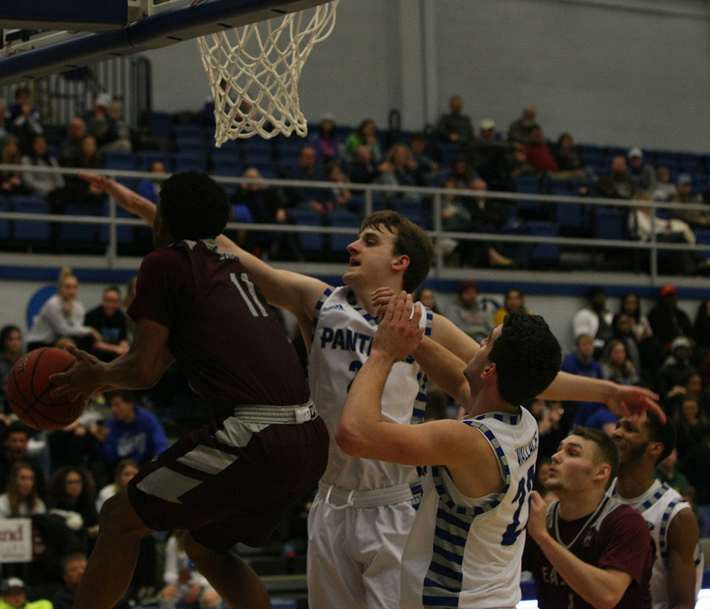 Ben Harvey tries to block an Eastern Kentucky player's shot attempt during Eastern's 67-66 win over the Colonels in Lantz Arena Jan. 31.