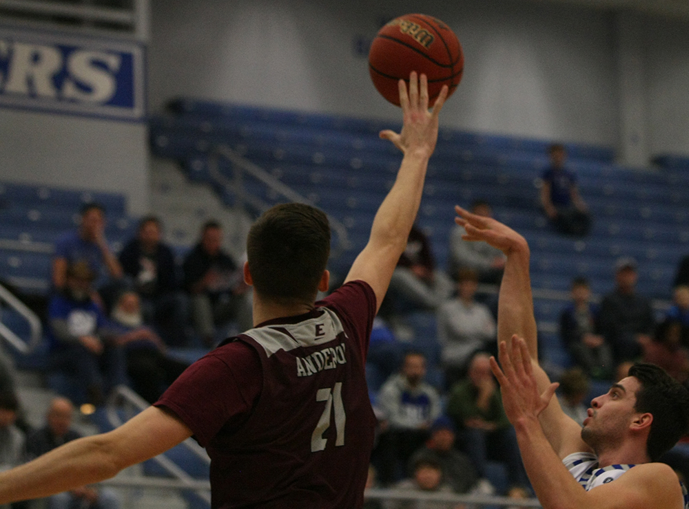 Josiah Wallace attempts a floater in the lane as an Eastern Kentucky defender flies to try and block it during Eastern's 67-66 victory in Lantz Arena Jan. 31.