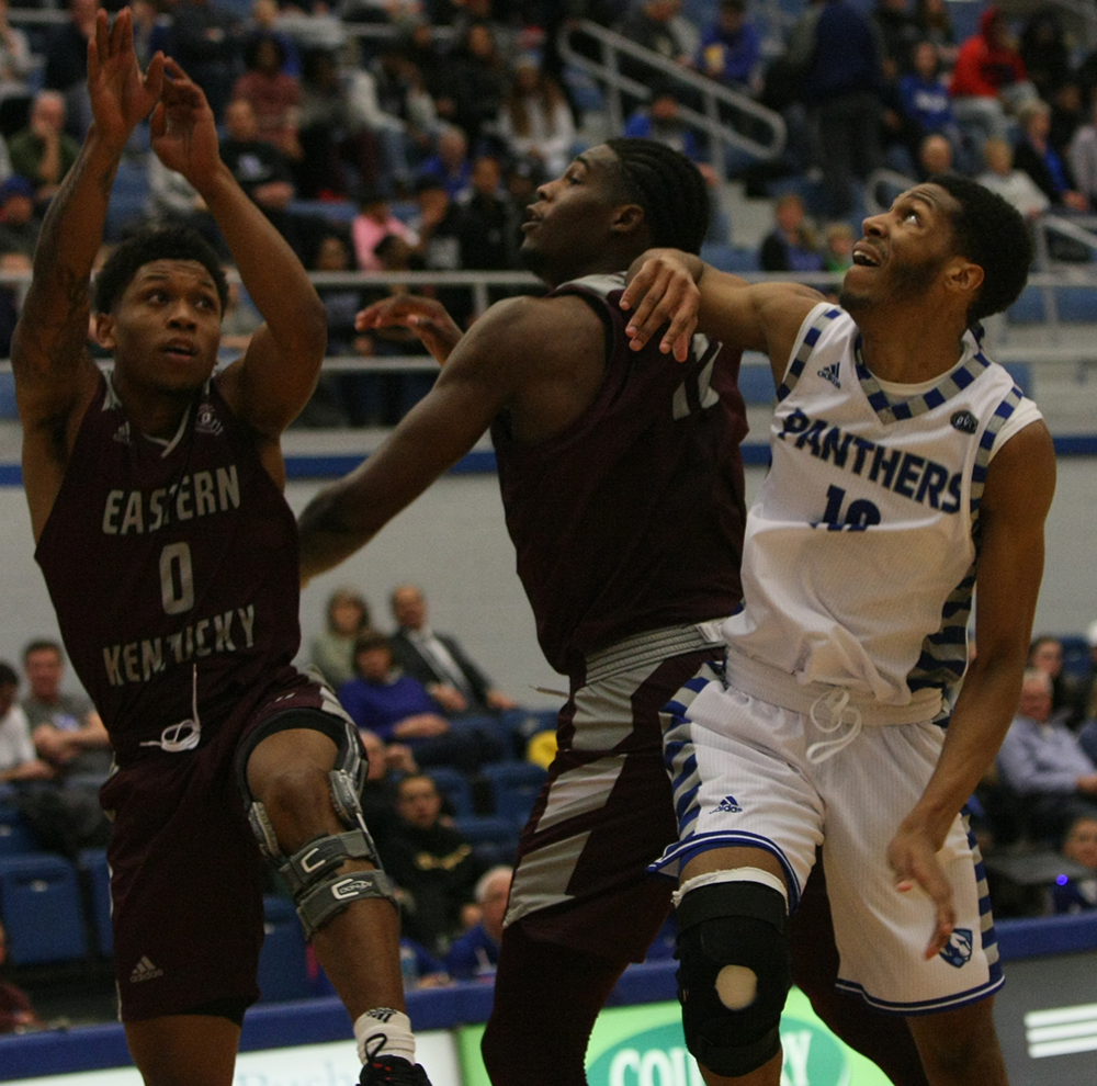 Cam Burrell works against two Eastern Kentucky defenders to fight for an offensive rebound during Eastern's 67-66 victory in Lantz Arena Jan. 31.