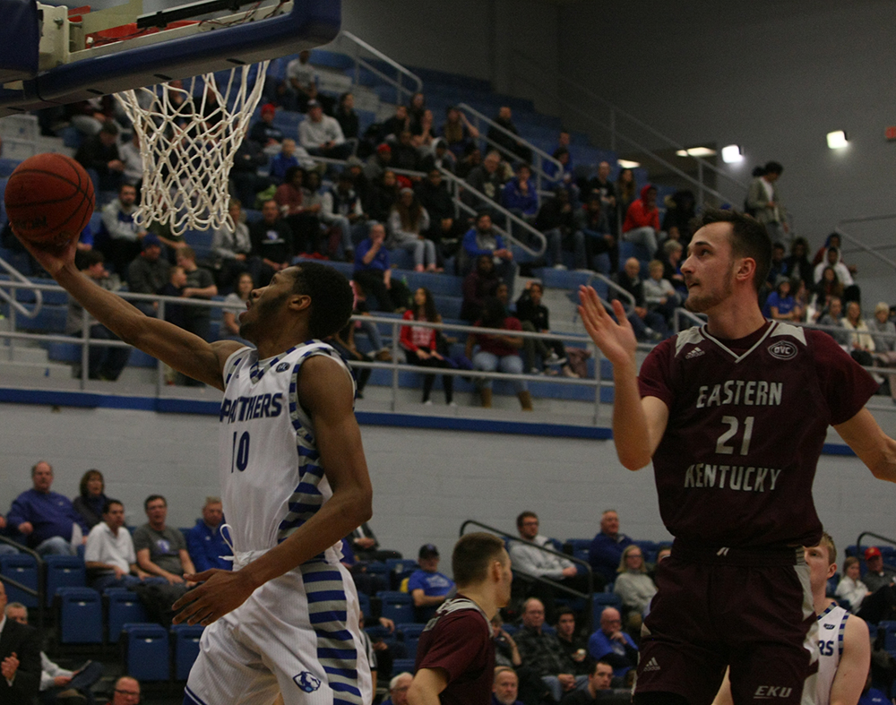 Cam Burrell attempts a reverse layup as an Eastern Kentucky defender misses his block attempt during Eastern's 67-66 victory in Lantz Arena Jan. 31.