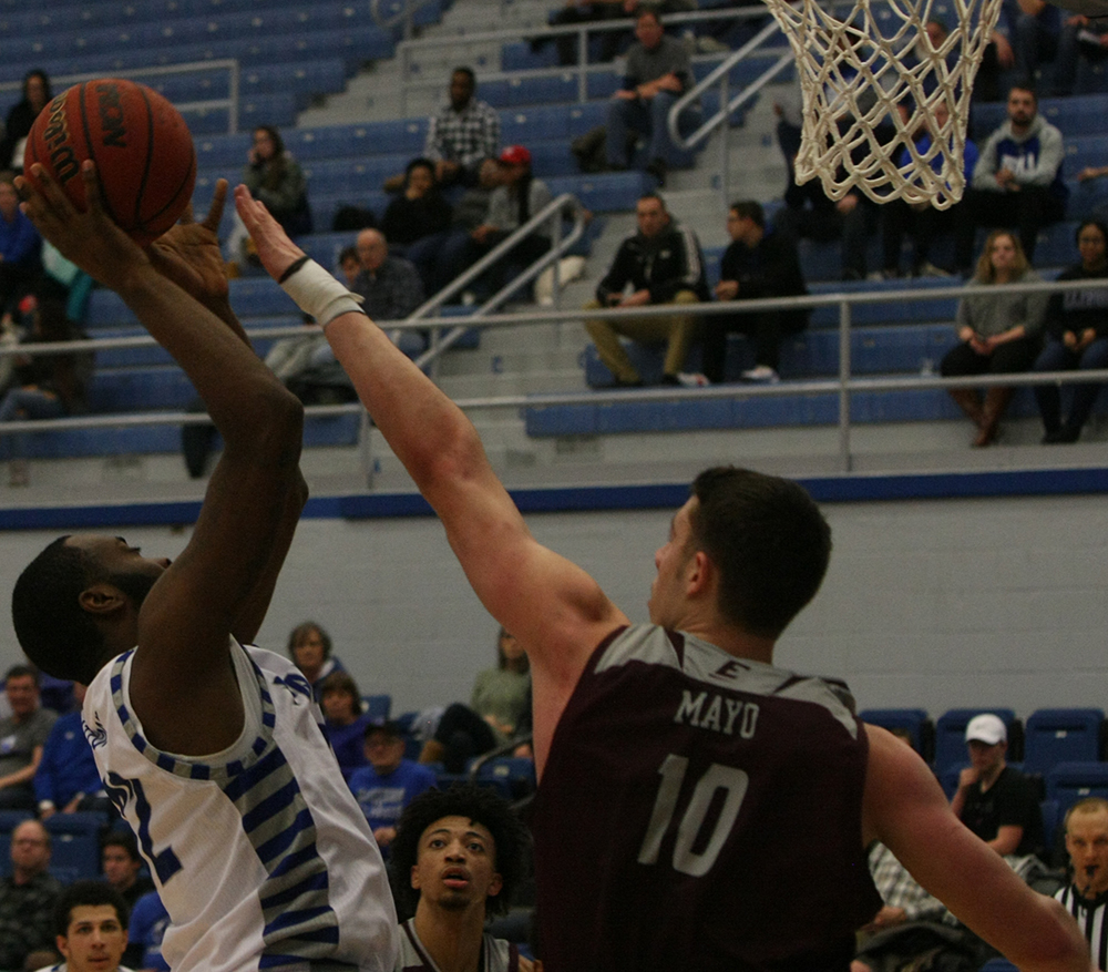 JaQualis Matlock attempts a shot attempt around the basket as Eastern Kentucky's Nick Mayo tries to block it during Eastern's 67-66 victory Jan. 31 in Lantz Arena.