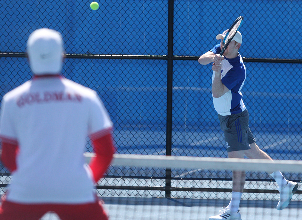 Freddie O'Brien returns a hit during the Eastern men's tennis match against Belmont in March 2018. Belmont swept Eastern 7-0.