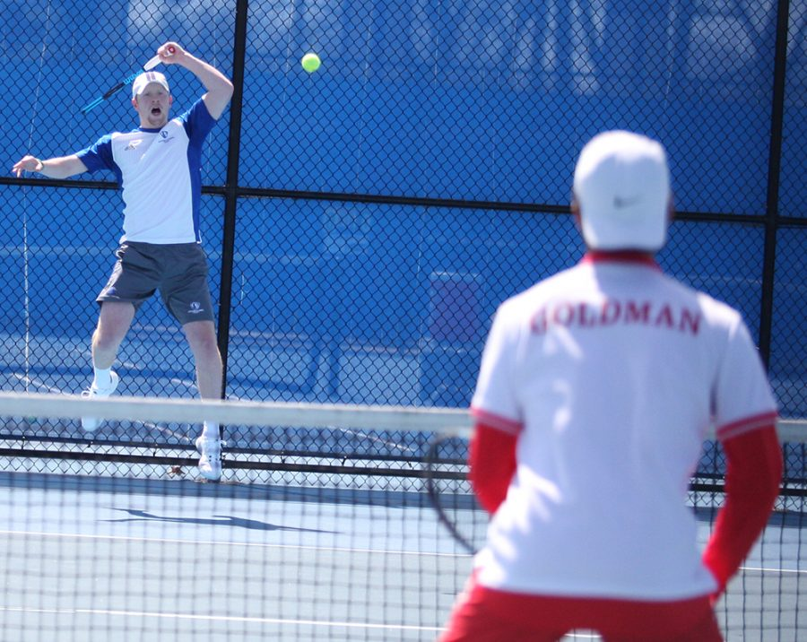 Freddie O'Brien returns a hit during the Eastern men's tennis team's 7-0 loss at the Darling Courts against Belmont in March of 2018.
