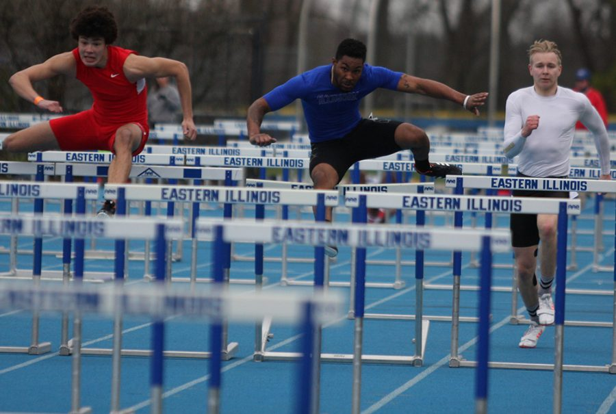 Cedric Johnson jumps over a hurdle during a hurdle race in the EIU Big Blue Classic at O'Brien Field in March 2018.