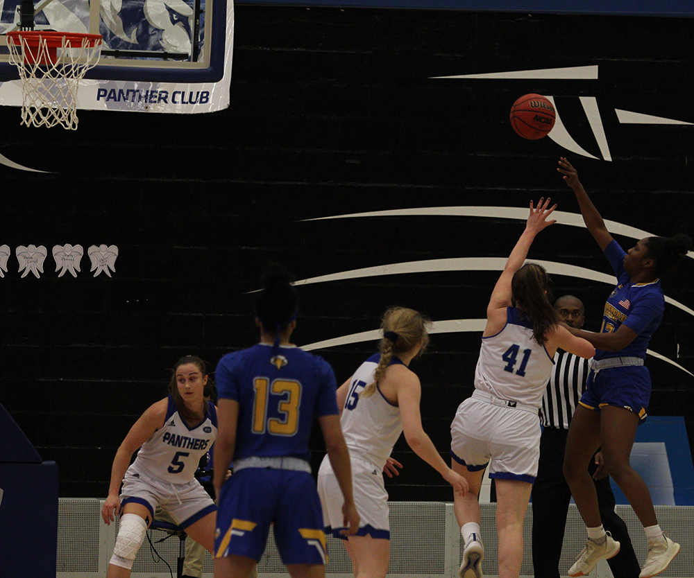Abby Wahl jumps to try and block a shot from a Morehead State player during Eastern's 67-57 loss in Lantz Arena Saturday.