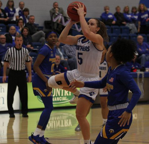 Dillan Schorfheide | The Daily Eastern News Grace Lennox elevates for a jump shot with a Morehead State defender right next to her during Eastern's 67-57 loss in Lantz Arena Saturday.