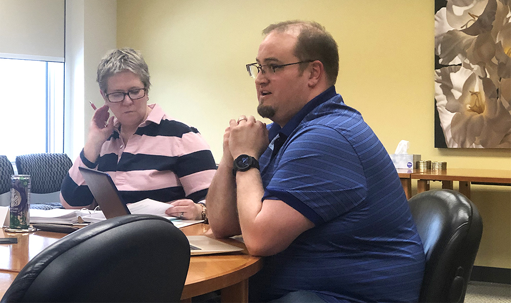 Nicholas Shaw (right), a professor of theater arts, and Marita Gronnvoll (left), chair of the Council of Academic Affairs, discuss revisions for a new theater course proposal Thursday afternoon at Booth Library. Nine theater related agenda items were approved during the meeting.