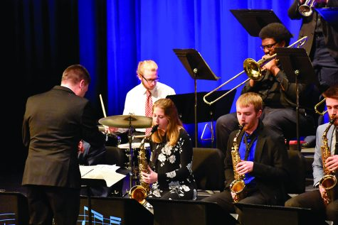 "The EIU Jazz Lab Band performs a free concert ""Jazz Goes to the Movies"" on Thursday evening in the Theatre of the Doudna Fine Arts Center. Paul Johnston (left), Professor of Jazz Studies and Jazz Piano, is the director in concert tonight."