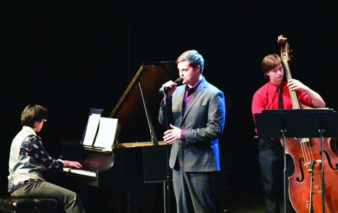 "Senior vocalist Logan Schmidt sings ""You've Got a Friend in Me"" from Toy Story and ""Wink and a Smile"" from Sleepless in Seattle during the ""Jazz Goes To The Movies"" concert in the Theatre of the Doudna Fine Arts Center on Thursday evening."