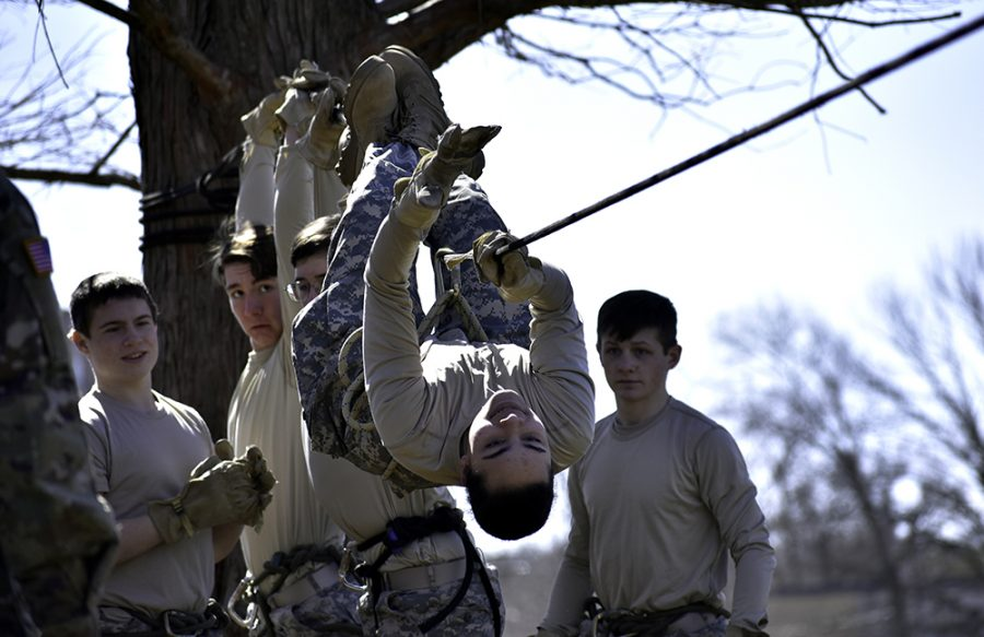 Students from Mattoon High School's JROTC cross a modified rope bridge during Panther Raider Challenge next to the Tarble Arts Center on Saturday morning.