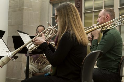 "Jenny Brown, a trumpet instuctor, and Will Porter, a trombone instructor, perform one of the five movements from ""Celestial Suite"" Wednesday afternoon at Booth Library. The five movements each highlight an astronomer or physicist."