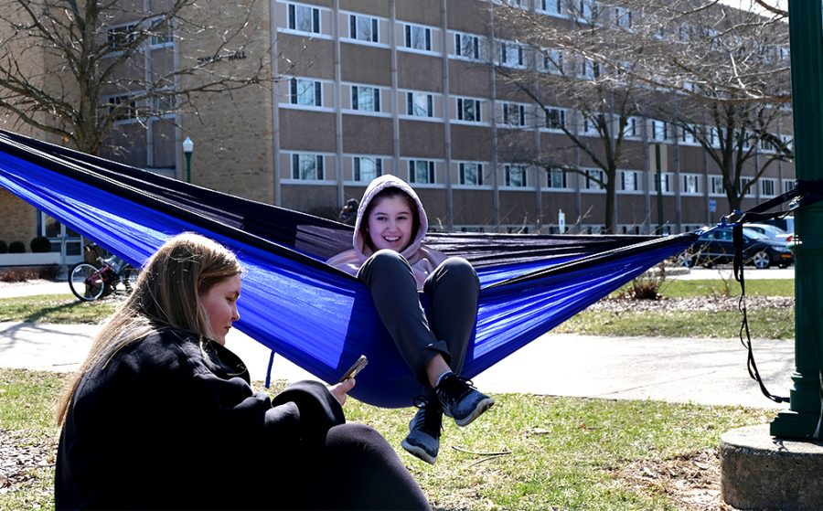 Sophomores Brittni Lawson, a pre-nursing major, and Sarah Fors, an elementary education major, talk with each other while hanging out Wednesday afternoon in the South Quad outside of Taylor Hall. Lawson said it was nice to get out and enjoy the weather.