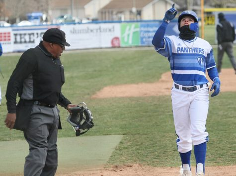 Eastern's Christian Pena celebrates after hitting a home run in Eastern's 10-9 loss to Southeast Missouri Sunday at Coaches Field. Eastern is now 5-5 in conference play.