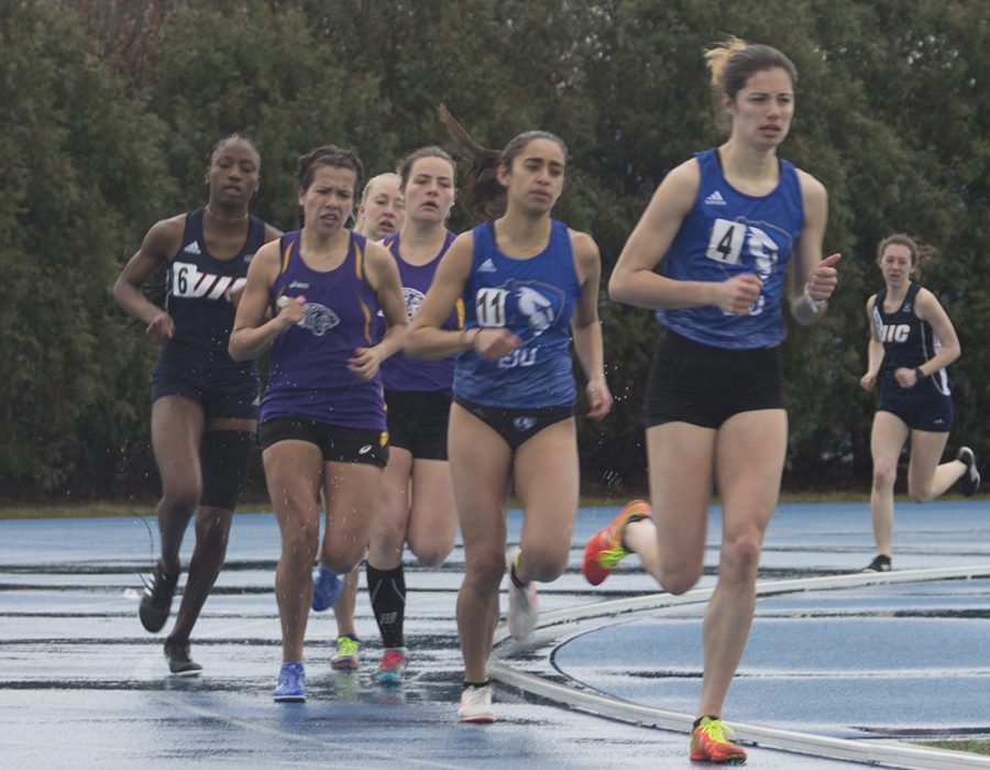 Summer Jacobs | The Daily Eastern News Eastern's Jocelyne Mendoza (11) and Grace Rowan (4) lead a pack of runners at the EIU Big Blue Classic this weekend at O'Brien Field.