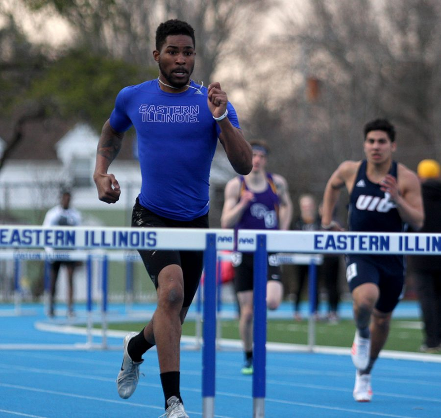 File Photo | The Daily Eastern News Eastern's Cedric Johnson races toward a hurdle in a meet last Spring at O'Brien Field. Eastern hosts the EIU Big Blue Classic this weekend.